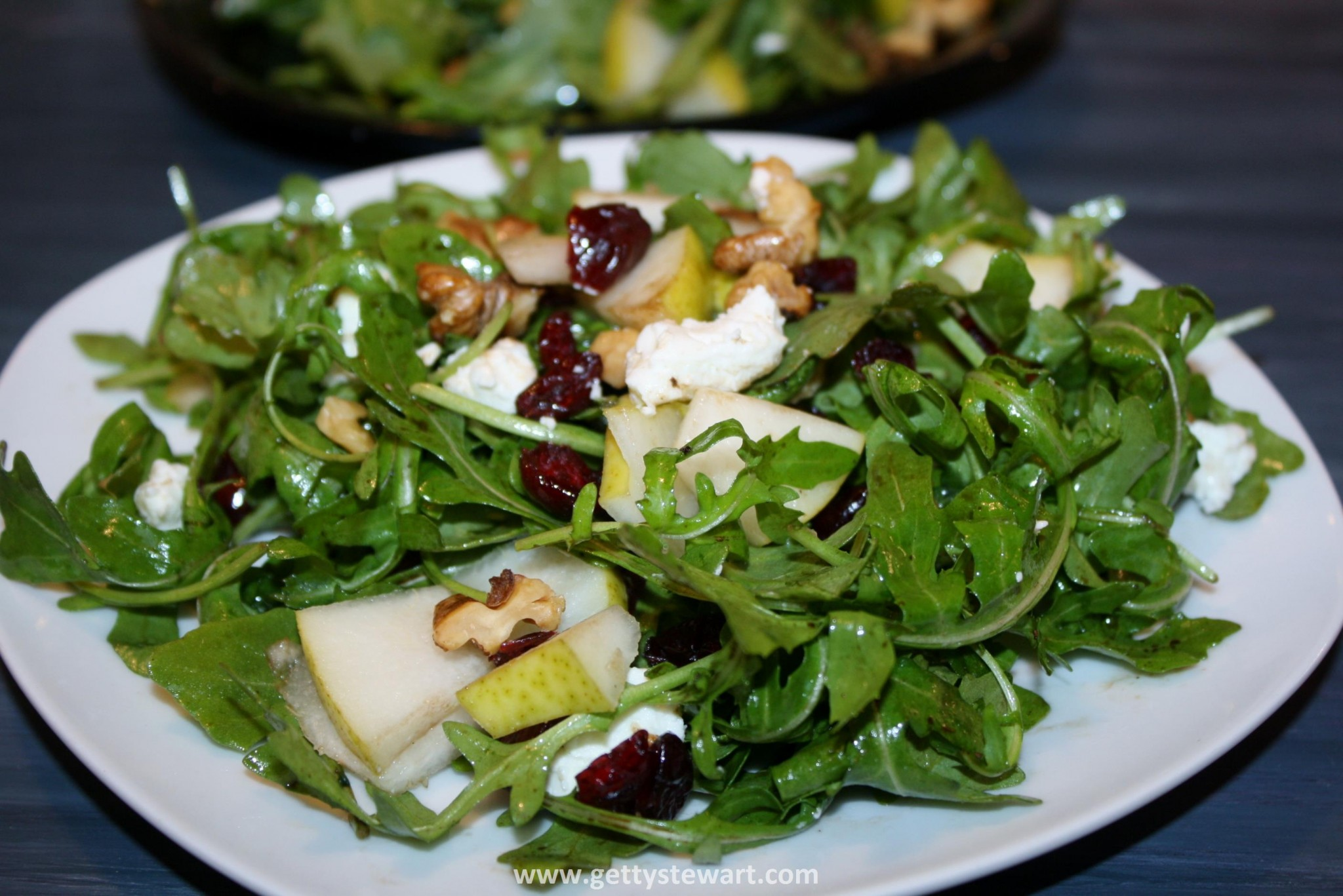 Pear & Arugula Salad with Goat Cheese, Walnuts and Cranberries