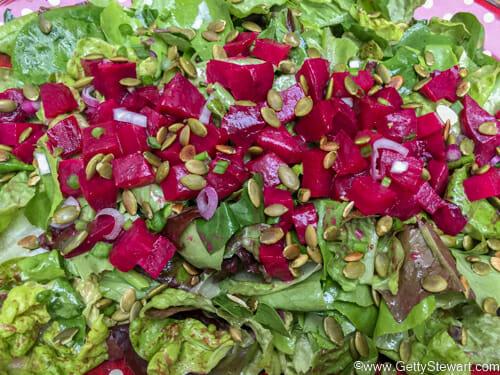 assembling roasted beet salad