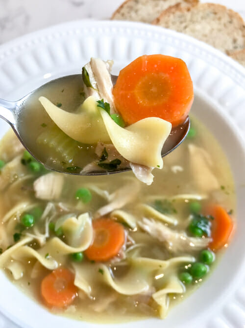 chicken noodle soup on spoon