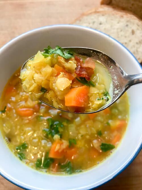 bacon lentil soup chunky on spoon